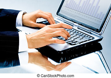 Computer work - Image of human hand typing a business...