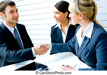 Necessary agreement - Successful people shaking hands making...