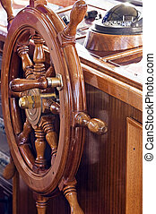 Rudder with compass in background on a yacht