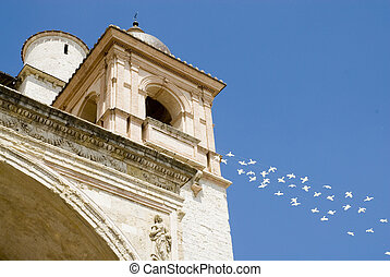 Assisi - Basilica of Saint Francis in Assisi with doves as a...