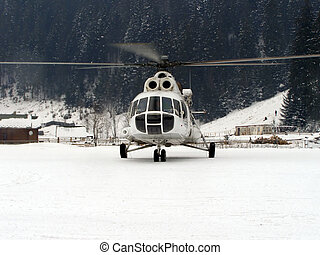 Helicopter - helicopter landed among the Carpathian...