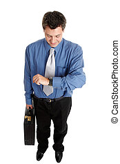 Businessman checking time - Businessman holding a briefcase...
