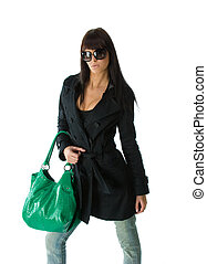 Young lady with purse - Young stylish brunette in sun...
