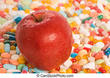 Apple and tablets - Conceptual photo of red apple with...