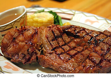 Thick steak - Big thick steak with garnishing corn and gravy