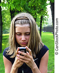 Blonde girl with phone - Young blonde girl with phone in...