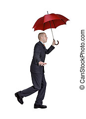 Umbrella man - Walking businessman with a red umbrella Full...