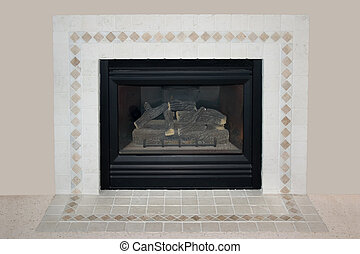 Fire Place - an unlit fireplace in a beige colored room