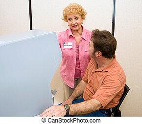 Volunteer Explains Voting Machine - Senior woman volunteer...