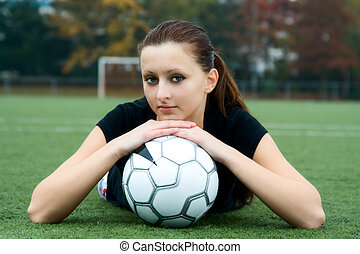 Soccer player - A beautiful soccer player resting on a...