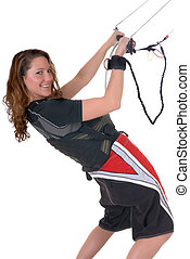 Mountain board kite surfing - Young attractive female doing...
