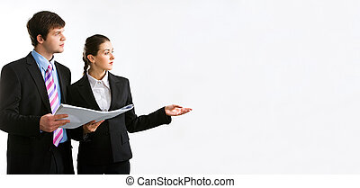 Two people - Image of two business people holding a document...