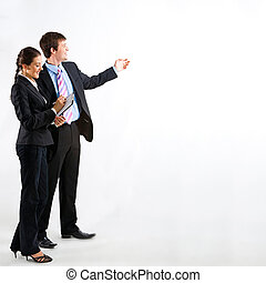 Teamwork - Portrait of business people standing on a white...