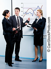 Business education - Portrait of successful man explaining a...