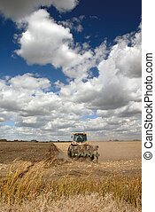 Tractor, Field, And Skies