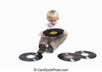 young boy with vinyl - young boy with retro black vinyl to...