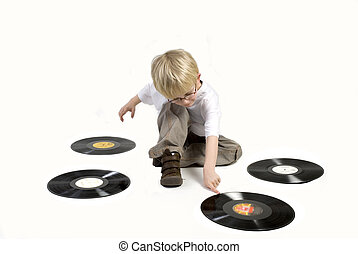 child with black vinyl - Toddler is playing with black...
