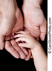Hands - two hands with father and his baby son