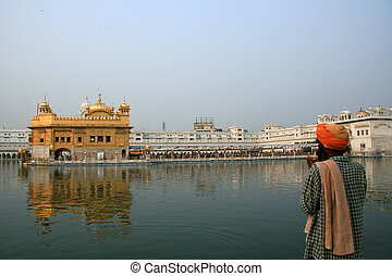 Sikh Man Praying at Golden Temple, Amritsar, India