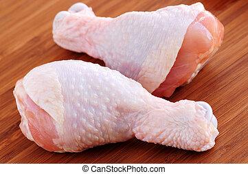 Raw chicken drumsticks