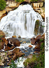 Waterfall - Cascading waterfall in wilderness in Ontario,...