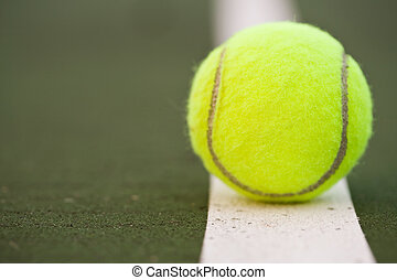 Tennis ball - A closeup shot of a tennis ball in a tennis...