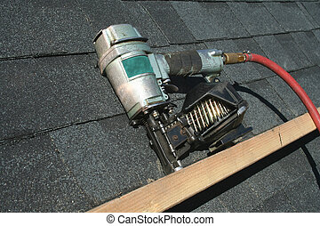 A Pneumatic roofing nail gun with air hose
