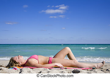 Beach - Beautiful Caucasian female teenage laying on the...