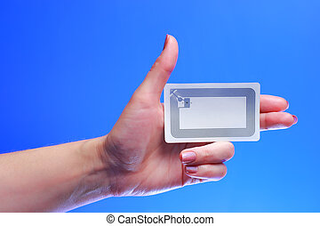 hand with EPC RFID tag - A studio shot of a woman holding in...