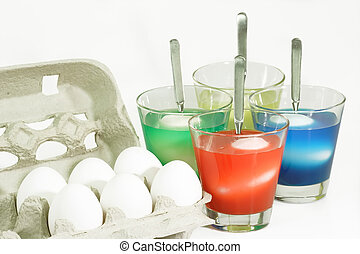 Easter Eggs - Dyeing colorful Easter eggs on bright...