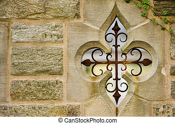 Metallic ornament - Stone wall of old university campus...