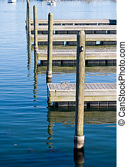 Piers - Vacant mooring piers with boat posts sticking out of...