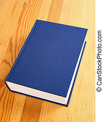 single book - single navy blue book over wooden background
