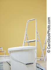 Pail. - White pail and orange background.