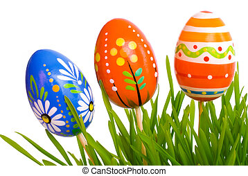 easter eggs - colored easter eggs in green grass on the...