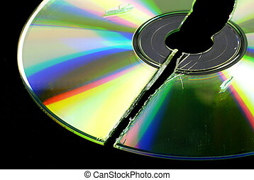 data loss -- broken CD or DVD isolated on black ground