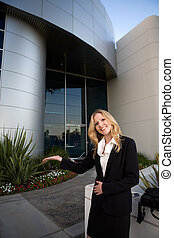 Real estate agent - Attractive blond business woman wearing...