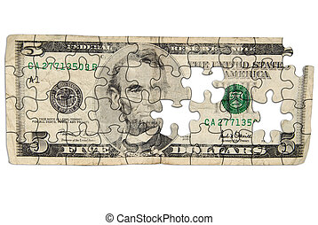 Worn Five dollar bill cut out into puzzle shapes isolated...