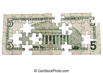 Worn Five dollar bill backside cut out into puzzle shapes...