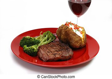 Steak and Potato - Grilled rib eye steak with baked potato...