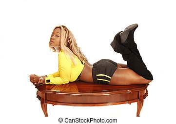 Young Jamaican girl - An blond young Jamaican girl lying on...