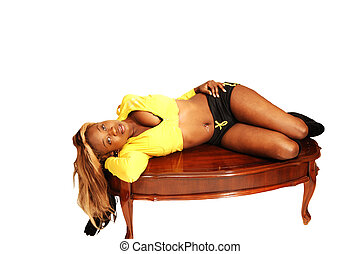 Young Jamaican girl 29. - An blond young Jamaican girl lying...