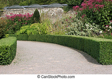 Curved Garden Pathway - Curved garden path with clipped...