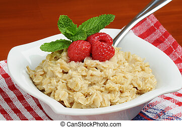 Oatmeal - Bowl of healthy oatmeal with fresh raspberries