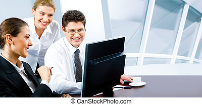 Business team - Team of three business people looking at...