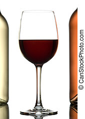 Wines. - Glass of wine between two bottles of wine isolated...
