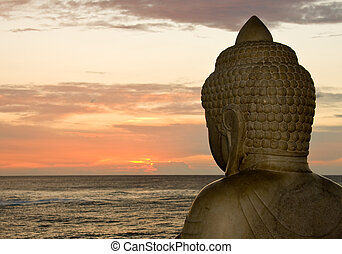Buddha and sunset - Side view of Buddha overlooking the...