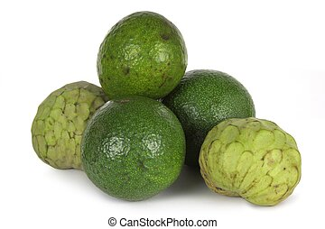 Custard apples and avocados on a white background.