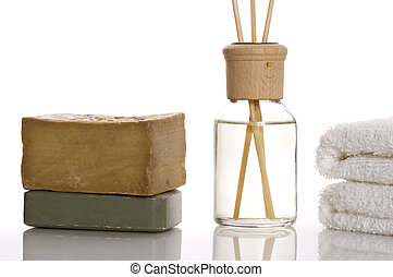 aroma therapy objects. bottle of esential oil, towels, soap