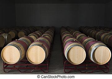 Wine barrels - Oak wine barrels in a modern winery,...